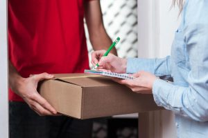 Woman receiving a package from the courier