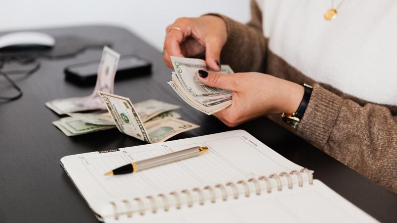 crop payroll clerk counting money